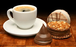 Cup of coffee and sweet chocolates Stock Images
