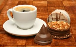 Cup of coffee and sweet chocolates Royalty Free Stock Photography