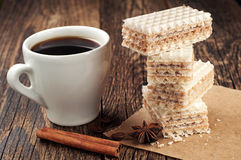 Cup of coffee and sweet waffles Royalty Free Stock Images