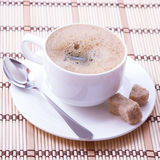 Cup of coffee, sweets and cane sugar cubes, square. Coffee concept. Selective focus. Royalty Free Stock Photography