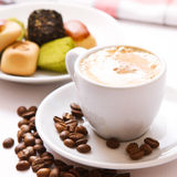 Cup of coffee, sweets and cane sugar cubes, square. Coffee concept. Selective focus. Royalty Free Stock Images