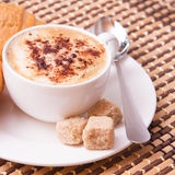 Cup of coffee, sweets and cane sugar cubes, square. Coffee concept. Selective focus. Stock Photo