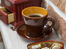 Cup of coffee, sweets, coffee grinder. still life Royalty Free Stock Photos