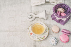 Cup of coffee with sweets and decorations  on the white cloth horizontal Royalty Free Stock Photo