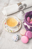 Cup of coffee with sweets and decorations  on the white cloth Royalty Free Stock Image