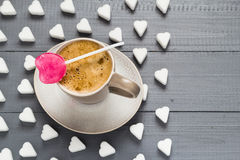 Cup coffee sweets heart shaped lollipop sugar cubes Royalty Free Stock Image