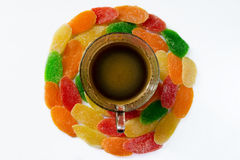 Cup of coffee and sweets - pineapple candied fruits on a white b Stock Images
