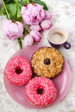 A cup of coffee,  sweets and rose flowers on the table Stock Images