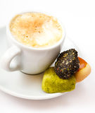 Cup of coffee and sweets on the saucer Stock Photography
