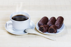 Cup of coffee and sweets stuffed with prunes Stock Image