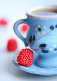 Cup of coffee with sweets. Cup of tea with raspberry sweets closeup, selective focus Stock Photos