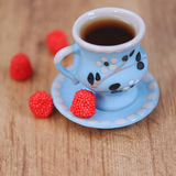 Cup of coffee with sweets. Cup of tea with raspberry sweets closeup, selective focus Royalty Free Stock Photography