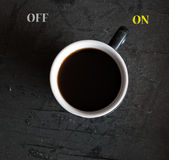 Cup of coffee switching on Royalty Free Stock Image