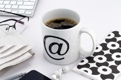 Cup of coffee with at symbol Royalty Free Stock Image