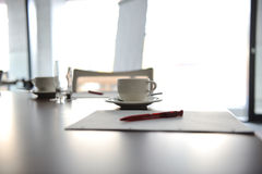 Cup of coffee on table Stock Photos
