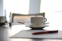 Cup of coffee on table Stock Images