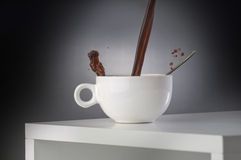 Cup of coffee on a table. Cup of black coffee with the tea spoon on a white wooden table Stock Photo