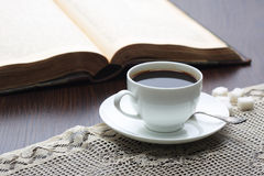 Cup of coffee on table with book Royalty Free Stock Image