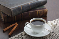 Cup of coffee on table with book Stock Photography