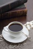 Cup of coffee on table with books Royalty Free Stock Images
