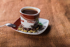 A cup of coffee on the table Stock Images