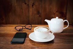 A cup of coffee on table in cafe.  royalty free stock images