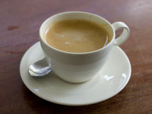 Cup of coffee on the table Royalty Free Stock Images