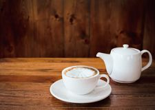 A cup of coffee on table in cafe.  stock photography