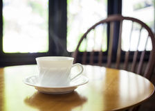Cup of coffee on table in cafe. Shop interior Stock Image