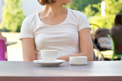 Cup of coffee on a table at the cafe Stock Image