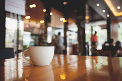 Cup of coffee on table in cafe. Vintage tone Royalty Free Stock Image