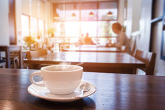 Cup of coffee on table in cafe royalty free stock image