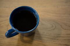 Cup of coffee on table in cafeteria Royalty Free Stock Images