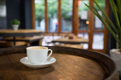 Cup of coffee on table at cafeteria Royalty Free Stock Photo