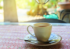 Cup of coffee on the table in coffee shop Stock Images