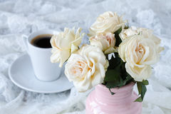 Cup of coffee on a table with flowers Stock Photos