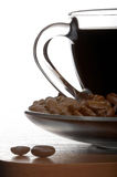 Cup of Coffee. On a table, isolated on white background Royalty Free Stock Images