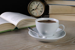 Cup of coffee at a table in the library Stock Photography
