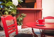 A cup of coffee on table, mediterranean style. Beautiful view of a red coffee cup on table Stock Image