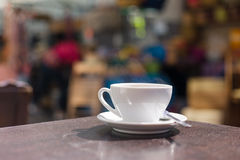 Cup of coffee on table outside Royalty Free Stock Photo