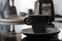 Cup of coffee on the table with people Stock Images