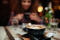 Cup of coffee on table at restaurant Royalty Free Stock Photography