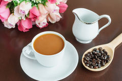 Cup of coffee on the table with rose Stock Photography
