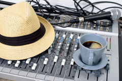 Cup of coffee on a table sound mixer Royalty Free Stock Image