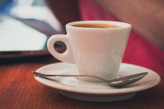 Cup of coffee on a table Stock Image