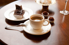 Cup of coffee. On a table. Spoon, candy, cake Stock Photo