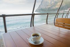 cup of coffee on the table of the summer cafe stock image