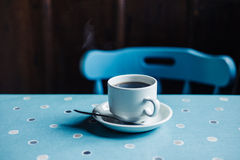 Cup of coffee on table in tearoom. A cup of freshly brewed coffee in a tearoom Stock Photo