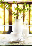 Cup of coffee on table on a terrace Royalty Free Stock Photography