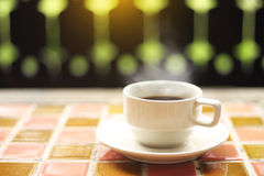 Cup of coffee on table at the terrace by morning light vintage Royalty Free Stock Image